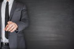 Businessman front of Blackboard Stock Image