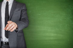 Businessman front of Blackboard Royalty Free Stock Photo
