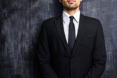 Businessman in front of blank blackboard Royalty Free Stock Image