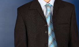 Businessman front of blue background Stock Photos