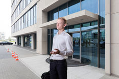 Businessman in front of business centre Stock Photography