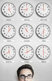 Businessman In Front Of Clocks Showing Time Across The World Royalty Free Stock Images