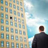 Businessman in front of company building. Stock Photos