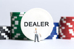 Businessman in front of a dealer sign and chips Royalty Free Stock Photo