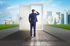 The businessman in front of door in business opportunities concept stock photography
