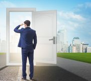 Businessman in front of door in business opportunities concept royalty free stock images