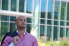 Businessman in front of glass building Stock Image