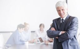 Businessman in front of his team stock photo