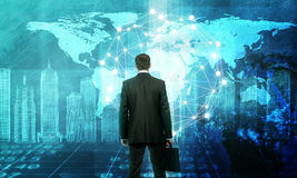 Businessman in front of holographic screen. With earth globe and 3d city model. Elements of this image furnished by NASA Royalty Free Stock Photography