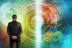 Businessman in front of holographic screen. With earth globe and figures. Elements of this image furnished by NASA Royalty Free Stock Photos