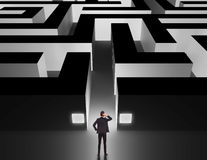 Businessman in front of a huge maze Royalty Free Stock Images