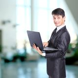 Businessman in front of laptop Stock Photos