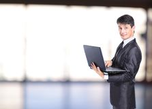 Businessman in front of laptop computer Stock Images