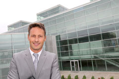 Businessman in front of modern building Royalty Free Stock Image