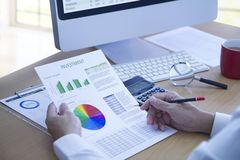 Reviewing annual reports in business investment analysis Stock Images