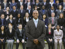 Businessman In Front Of Multiethnic Executives Stock Image