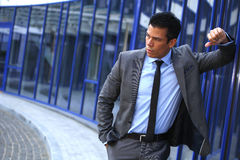 Businessman In Front Near Business Center Building, Gray Suit Royalty Free Stock Photography