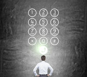 Businessman in front of number buttons Royalty Free Stock Photos