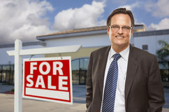 Businessman In Front of Office Building and For Sale Sign Royalty Free Stock Photo