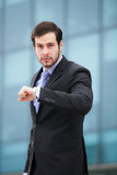 Businessman in front of an office building Royalty Free Stock Image