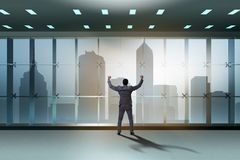 The businessman in front of office window thinking of new challenges. Businessman in front of office window thinking of new challenges royalty free stock photo