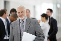 Businessman in front of sales team Stock Photos