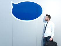 Businessman in front of thought bubble Stock Images