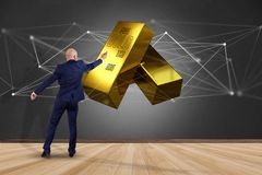 Businessman in front of a wall with gold bullion shinning in fro. View of a Businessman in front of a wall with gold bullion shinning in front of connection - 3d royalty free stock photos