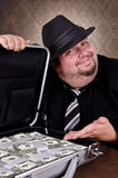 Businessman full of cash Royalty Free Stock Image
