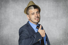 Businessman in a funny hat and a funny haircut Stock Photos