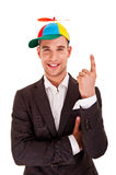 Businessman in funny hat Stock Photography
