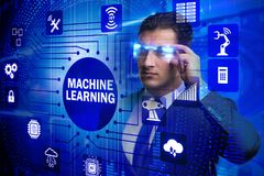 The businessman with futuristic glasses in machine learning concept. Businessman with futuristic glasses in machine learning concept Stock Photo