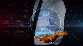 Businessman with 5G symbol hologram stock video footage