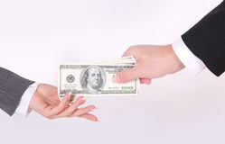 Businessman gaiving money to woman hand Stock Photo