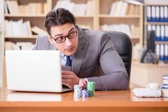 The businessman gambling playing cards at work Royalty Free Stock Image