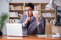 The businessman gambling playing cards at work stock images