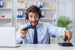 The businessman gamer in office playing games Stock Images