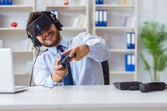 The businessman gamer in office playing games Royalty Free Stock Image