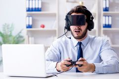 The businessman gamer in office playing games Royalty Free Stock Photos