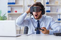 The businessman gamer in office playing games Stock Photos