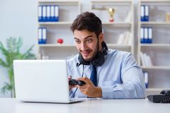 The businessman gamer in office playing games Stock Photo