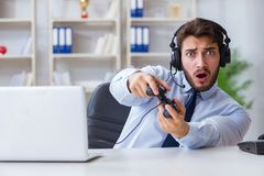 The businessman gamer in office playing games Royalty Free Stock Photo