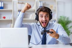 The businessman gamer in office playing games Royalty Free Stock Images