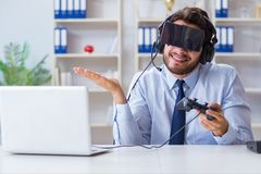 The businessman gamer in office playing games Stock Photography
