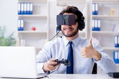 The businessman gamer in office playing games Royalty Free Stock Photography