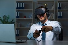 The businessman gamer staying late to play games Stock Photography