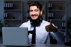 The businessman gamer staying late to play games. Businessman gamer staying late to play games Stock Photo