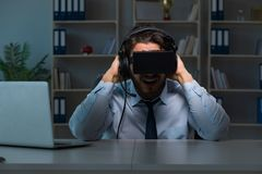 The businessman gamer staying late to play games Royalty Free Stock Images