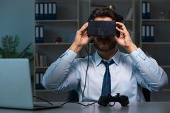 The businessman gamer staying late to play games Stock Images