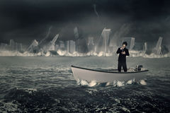 Businessman with gas mask on the boat Stock Photo